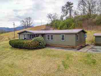 169 Roberts Shop Road in Waynesville, NC 28786 - MLS# 3592316