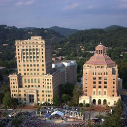 photo of crowds filling Pack Square Park in front of city and county buildings in downtown Asheville