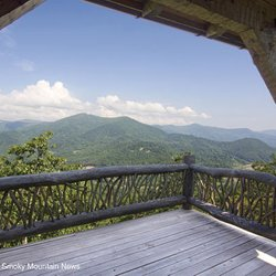 Photo of a Natural Covered Porch Looking out at the Blue Ridge Mountains