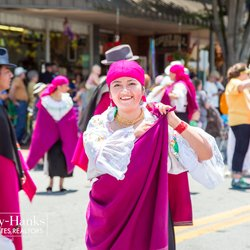 Photo of Woman Holding Her Purple Dancing Outfit