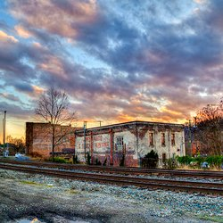 sunset photo of old buildings in Asheville's River Arts District