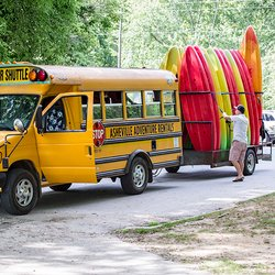 Photo of a Bus being Loaded up with Kayaks